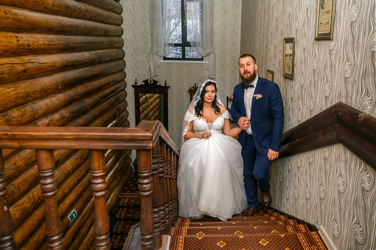 Newlyweds, a staircase, wedding number for newlyweds, hotel Abazhur Tomsk